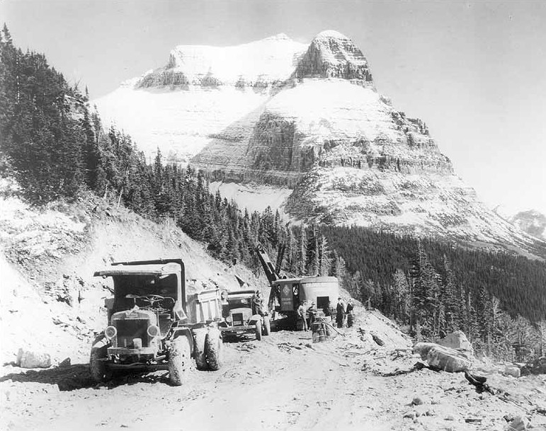 Road construction along the Going-to-the-Sun Road with Going to the Sun Mountain in background, 1932