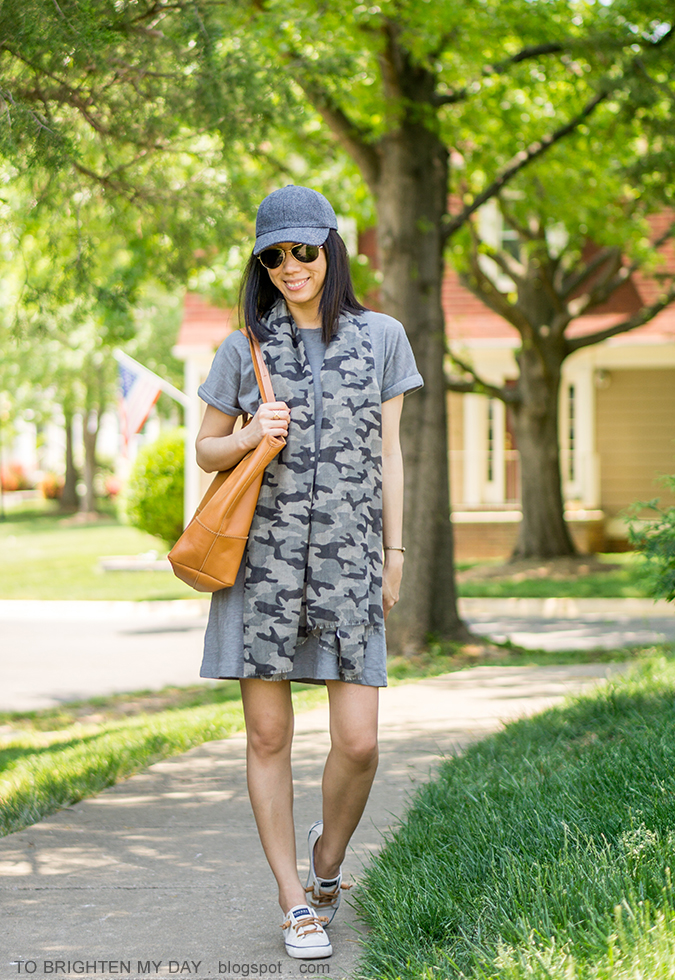 gray wool baseball cap, gray green tee shirt dress, camo patterned scarf, cognac brown tote, canvas sneakers