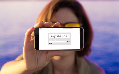 woman showing captcha on phone screen