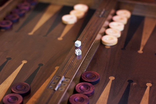 Wooden brown backgammon game with a dice