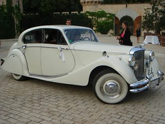 packard super eight(0.0), packard 120(0.0), rolls-royce phantom iii(0.0), rolls-royce silver dawn(0.0), bmw 327(0.0), touring car(0.0), convertible(0.0), automobile(1.0), jaguar mark iv(1.0), vehicle(1.0), antique car(1.0), sedan(1.0), classic car(1.0), vintage car(1.0), land vehicle(1.0), luxury vehicle(1.0),