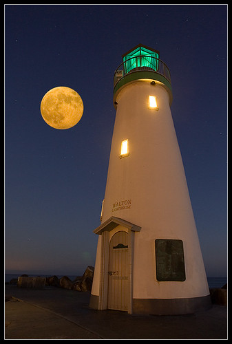 lighthouse under autumn moon