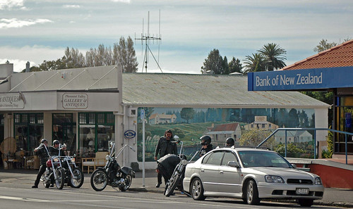 Motorcyclists pause in front of a Katikati mural