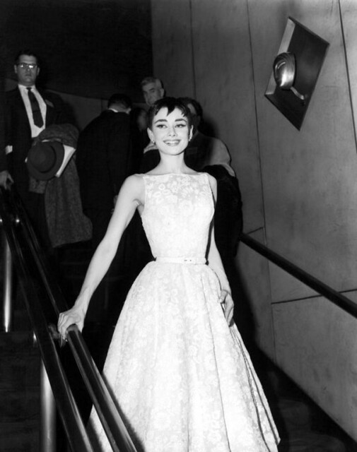 Audrey Hepburn wearing a gown by Givenchy for the 1954 Academy Awards ceremony at the Pantages Theatre in Hollywood
