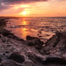 Beautiful sunset at the rocky coastline
