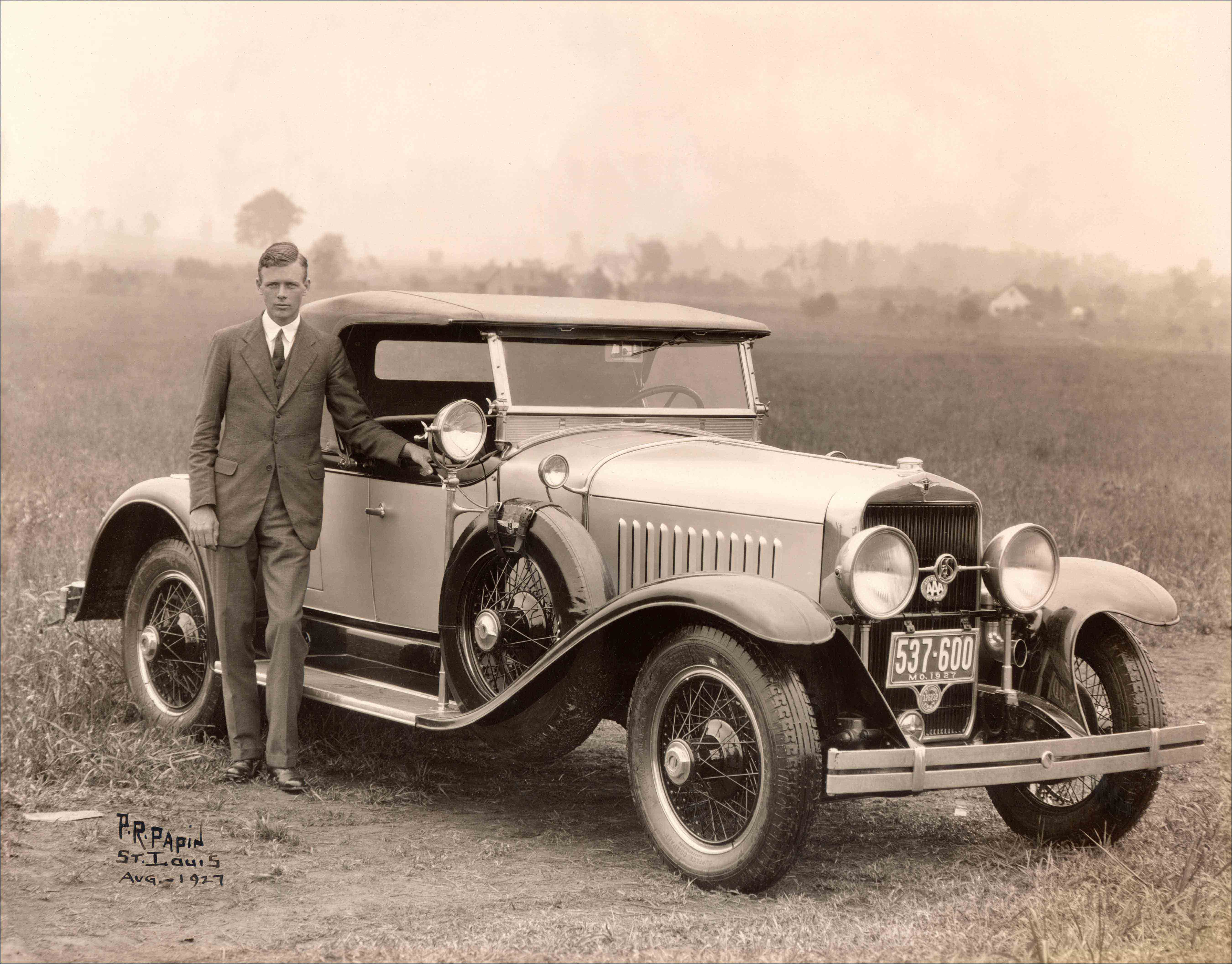 Charles Lindbergh poses next to a 1927 LaSalle roadster at Lambert Field, St. Louis, Missouri, on August 15, 1927.