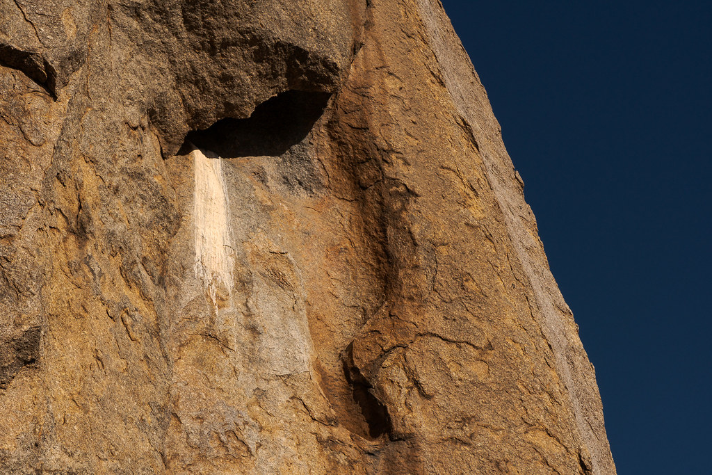 Bird waste flows down the rock face of Tom's Thumb in McDowell Sonoran Preserve in Scottsdale, Arizona