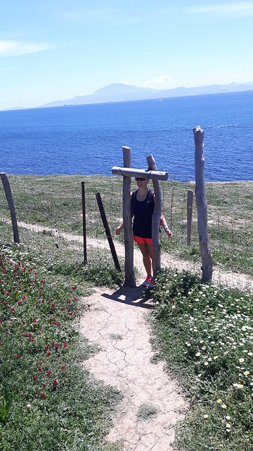 trying to fit through a gate in Tarifa hiking.