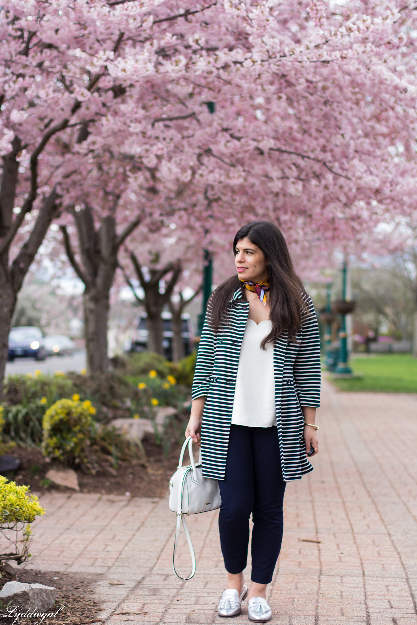 Striped trench, scalloped cami, navy pants, silver loafers