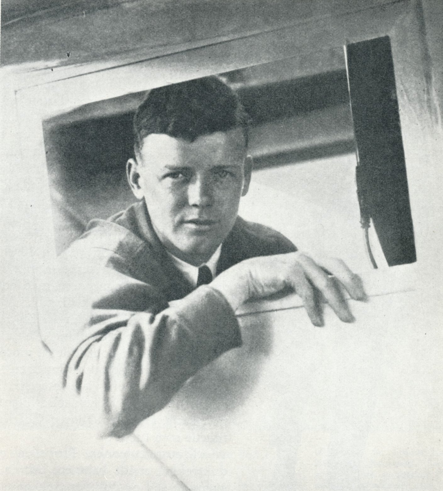 Charles Augustus Lindbergh poses in the right-side cockpit window of Spirit of St. Louis, 1927.