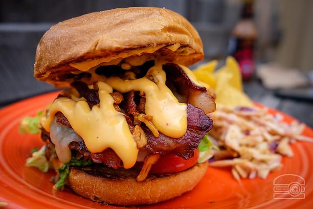 Burger w/ w/ caramelized onion, bacon, sharp white cheddar, garlic chips, and chili aioli - Black Bear Burritos Evansdale
