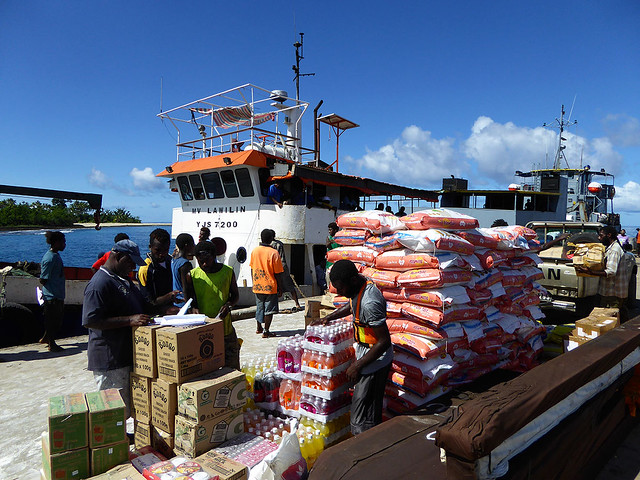 Cargo ferry arriving on a remote Vanuatu island with imported food, which local Ni-Vanuatu are becoming increasingly reliant on.