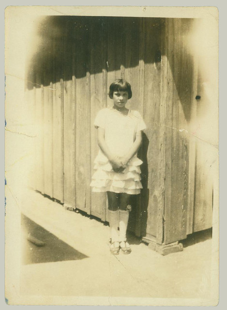 Girl at the corner of the shed