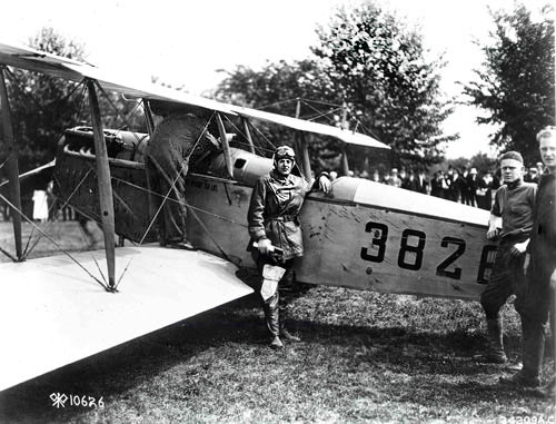 Army Major Reuben H. Fleet stands in front of a Curtiss JN-4H