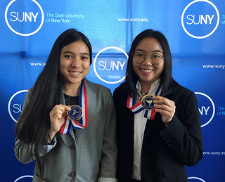 Tue, 03/06/2018 - 13:02 - Joana Reiko Sato (left) and Yuki Lai (right) with their PTK Induction medals