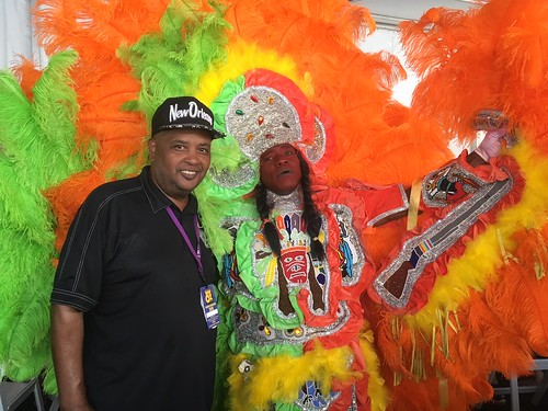 WWOZ Hospitality Tent Action Jackson with Creole Apache Big Chief on Day 4 Jazz Fest - May 3, 2018. Photo by Carrie Booher.