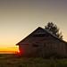 Midsummer Sunset Behind A Barn House by k009034