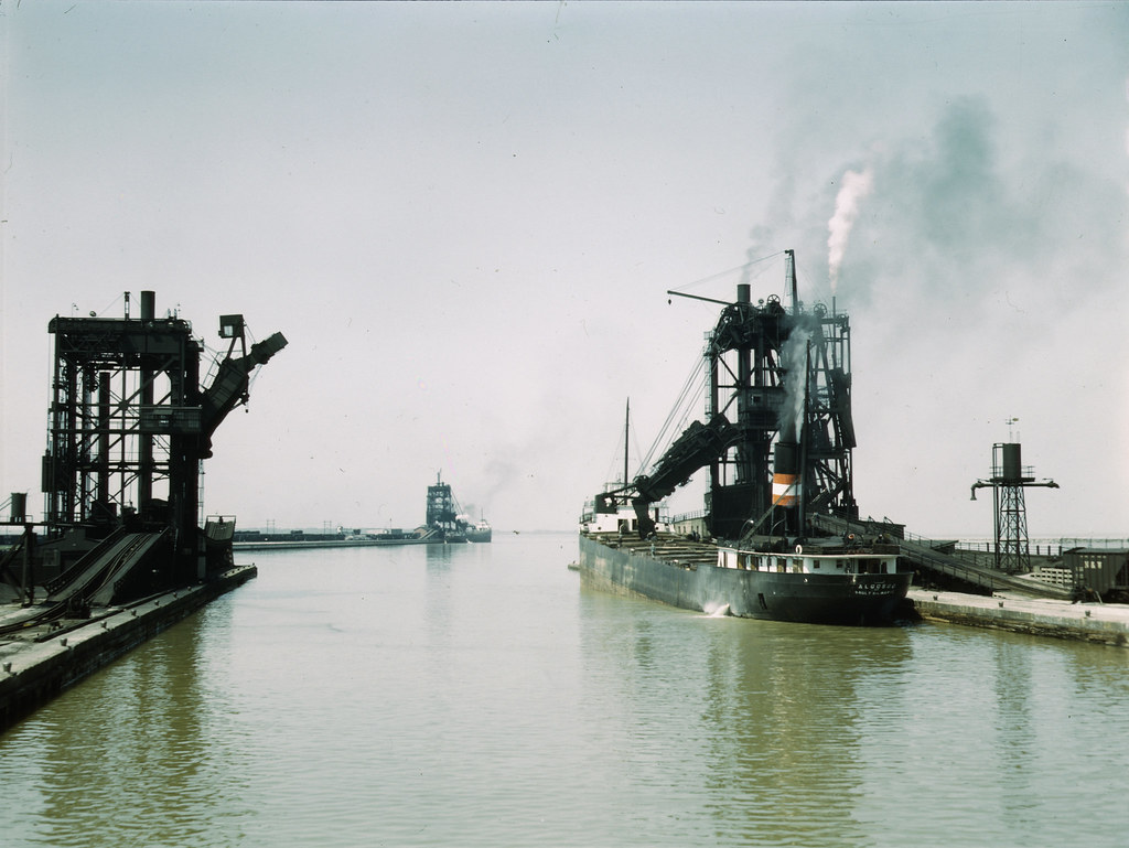 Ore being unloaded from the lake steamer Algosoo of Sault Ste. Marie at Pennsylvania R.R. ore docks, Sandusky, Ohio. 1943 May