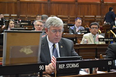 Rep. Storms reads through legislation on the last day of session