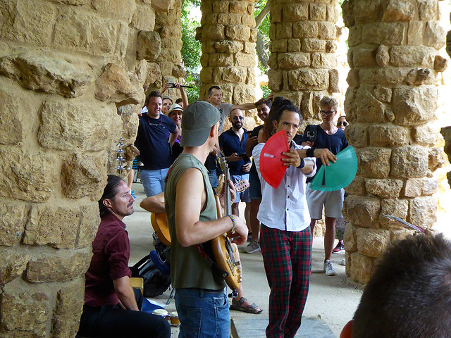 A male flamenco band is a highlight in Park Guell  in Barcelona Spain.