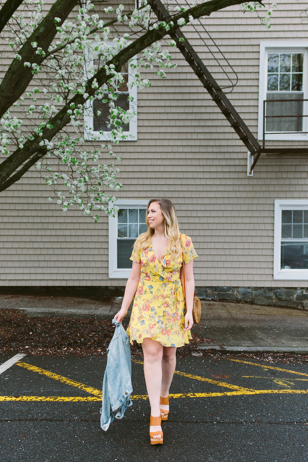 Nordstrom Lush Yellow Ruffle Wrap Dress Rattan Round Straw Bag Gap Jean Jacket Tan Wedges Sandals Spring Summer Outfit Inspiration Jackie Giardina Living After Midnite