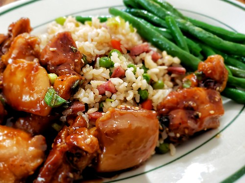 Honey sesame chicken with  fried rice and green beans