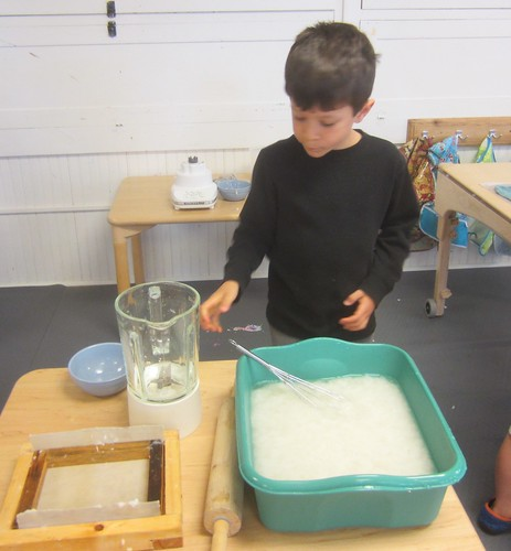 stirring the pulp in the water