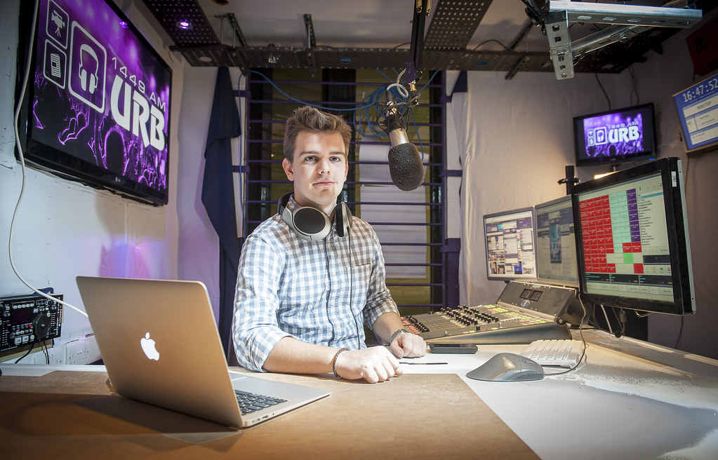 University Radio Bath (URB) showing a male student hosting a radio programme for the Spanish radio station