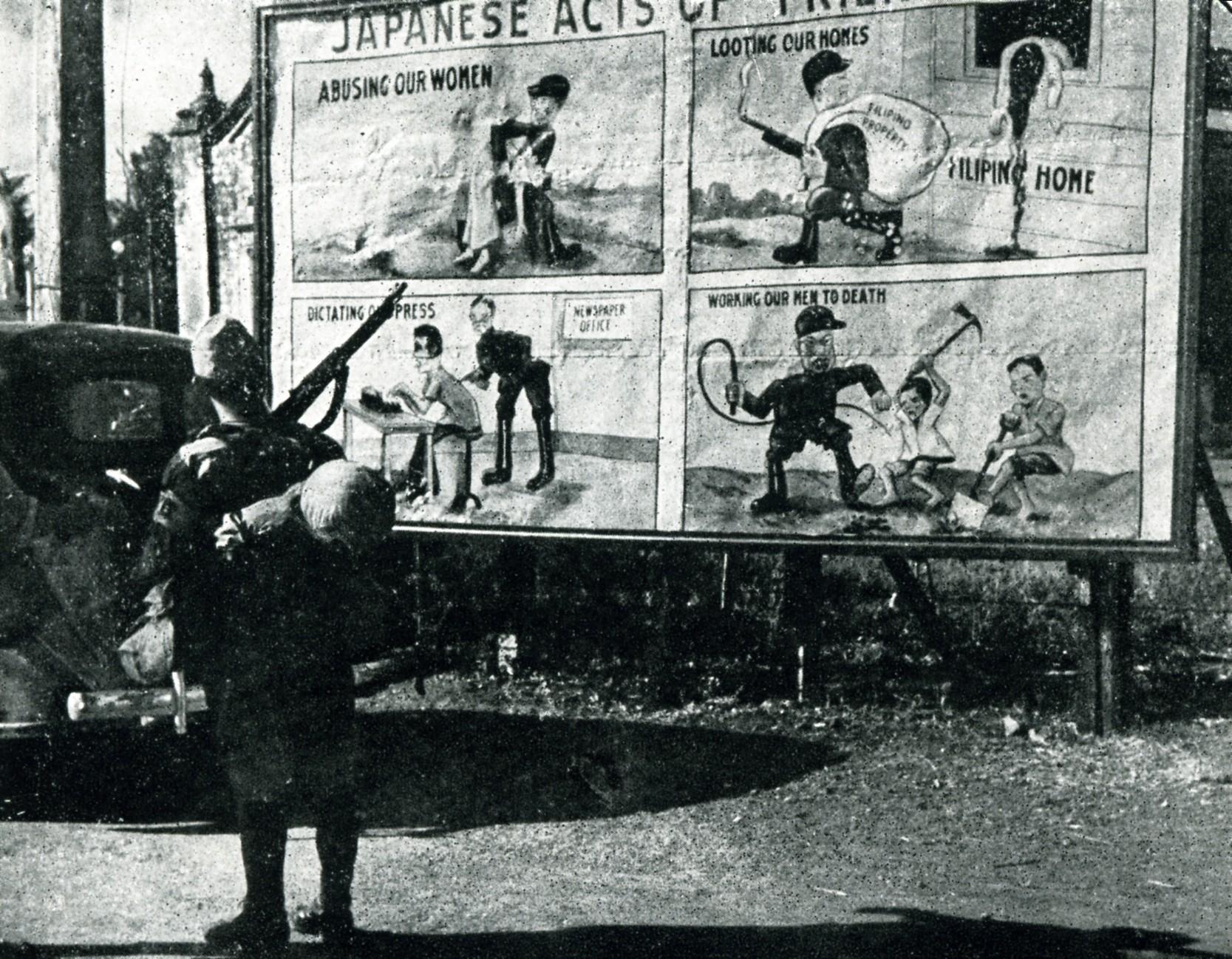Japanese solider and U.S. propaganda posters in Manila, Philippines, circa 1942.