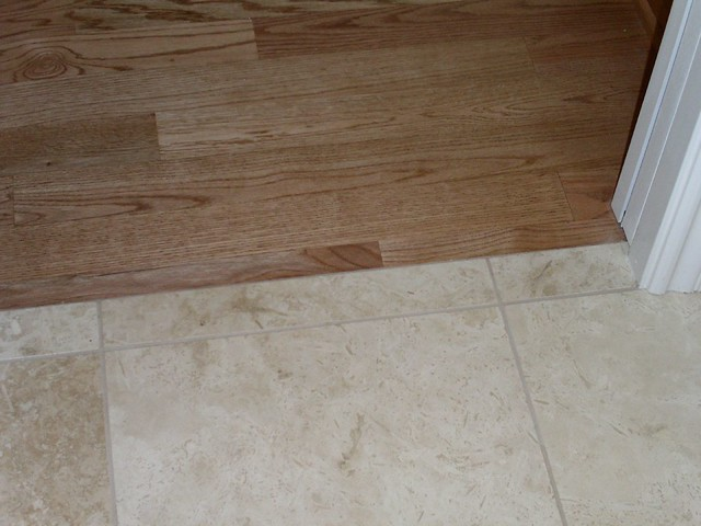 oak hardwood floor next to tile flickr photo sharing