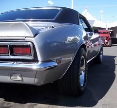 pontiac firebird(0.0), convertible(0.0), automobile(1.0), automotive exterior(1.0), wheel(1.0), vehicle(1.0), pony car(1.0), bumper(1.0), land vehicle(1.0), muscle car(1.0), sports car(1.0),