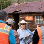 Lab historian stands in front of Pond Cabin on a tour.
