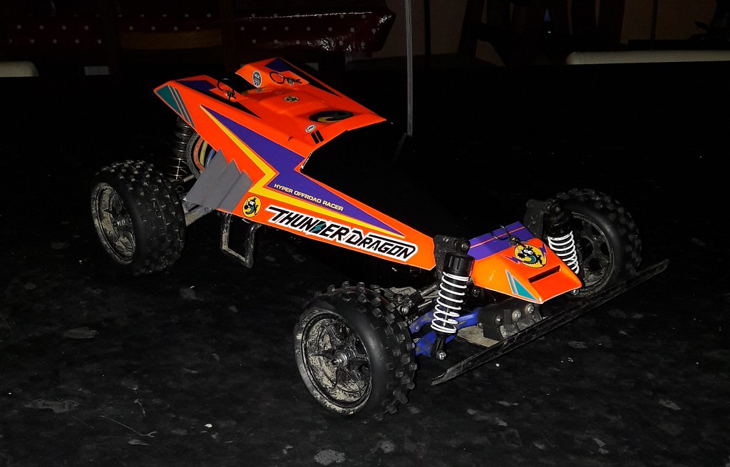 Tamiya 58073 Thunder Dragon alternative colour scheme. Neon orange with decals in purple/yellow/teal