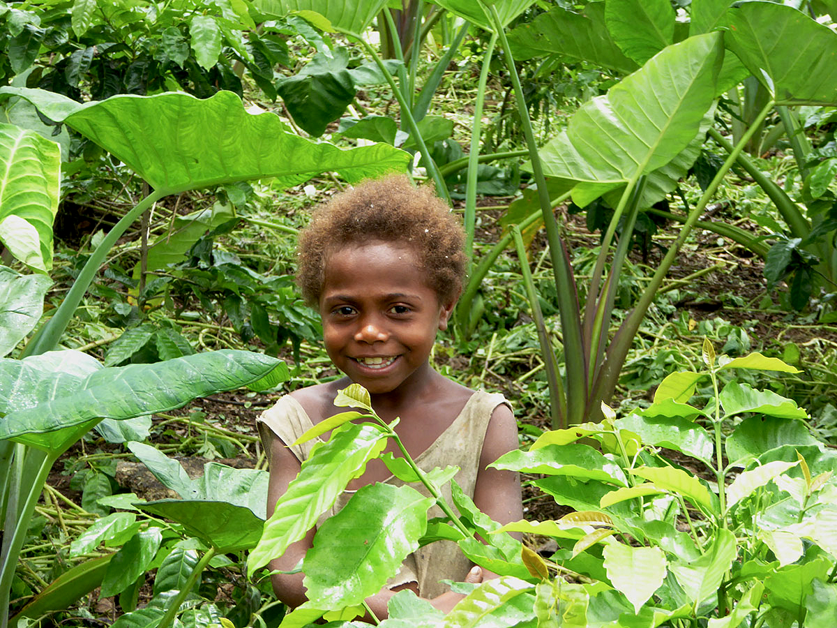 Local Girl in Village Garden  in Tannese Community moving from a reliance from subsistence farming to community based tourism