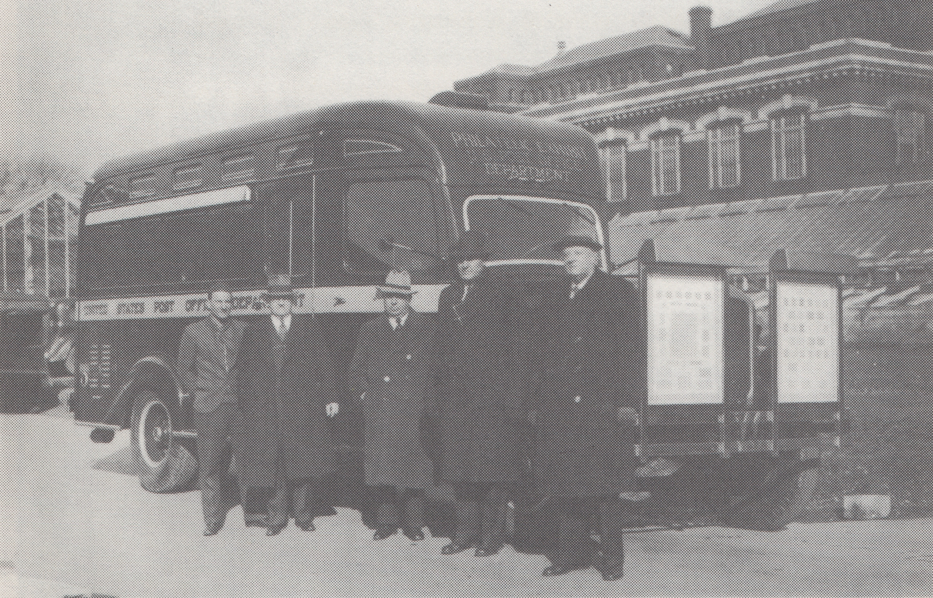 Bureau of Engraving and Printing officials pose with the Philatelic Truck outside of the BEP in Washington, D.C., circa April 1939. Note the two display frames mounted to the front bumper.