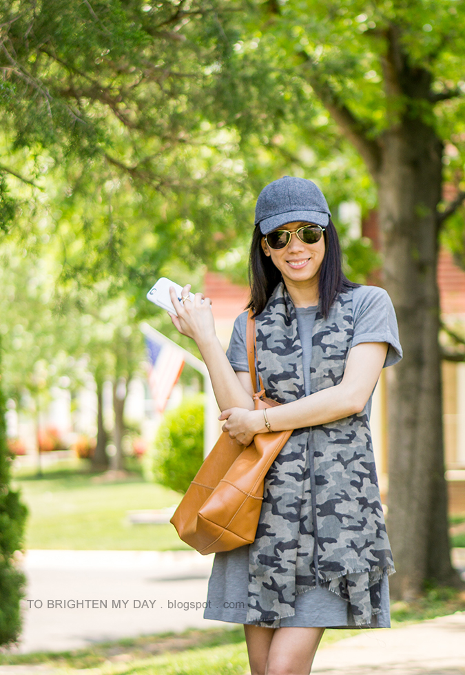 gray wool baseball cap, gray green tee shirt dress, camo patterned scarf, cognac brown tote