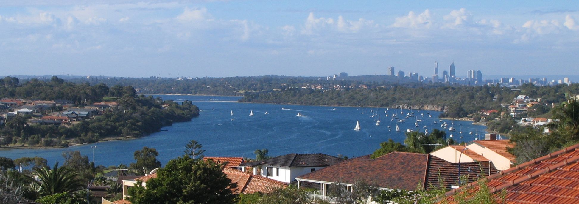 iew from East Fremantle, Western Australia, along Blackwall Reach of the Swan River towards Point Walter, with the Perth skyline in the background. Photo taken on April 10, 2004.