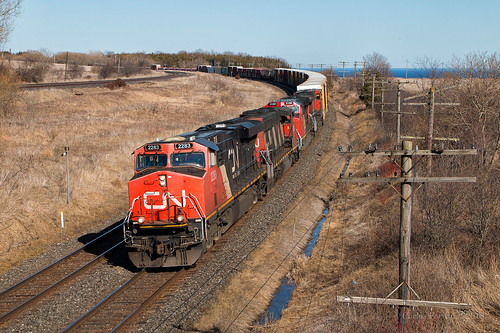 cn canadian national train trains ge emd locomotive kingston subdivision lakeside lovekin on ontario es44ac manifest freight rails codeline lake water