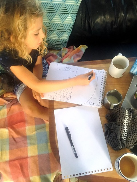 Up early designing her tiny house.
