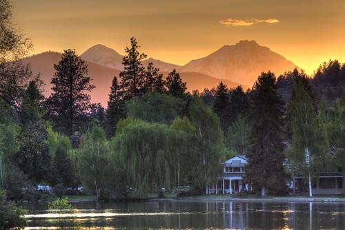 sunset river trees mountain orange green water
