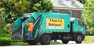 Baltimore city garbage sanitation truck with environmental message
