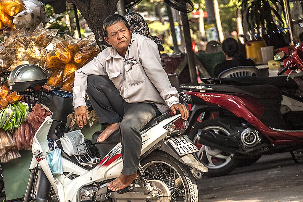 Motorcycle taxi driver--Saigon