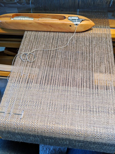 Weaving with end feed shuttle by Bluster Bay on Schacht Mighty Wolf loom 3-shaft Ms and Os