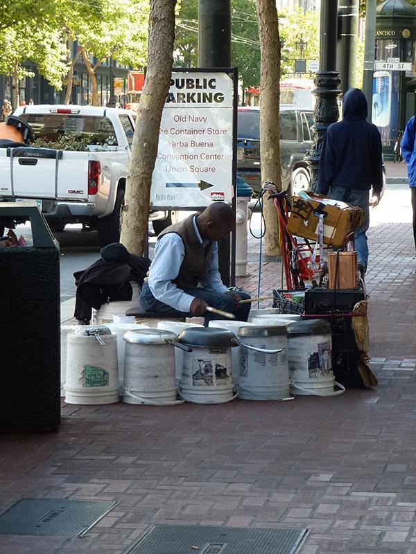 Semi-Busker playing frying pans on Meket street in San Francisco
