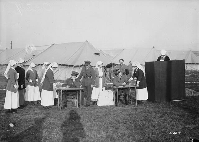 Nursing sisters at a Canadian military hospital in France voting in the Canadian federal election, 1917.