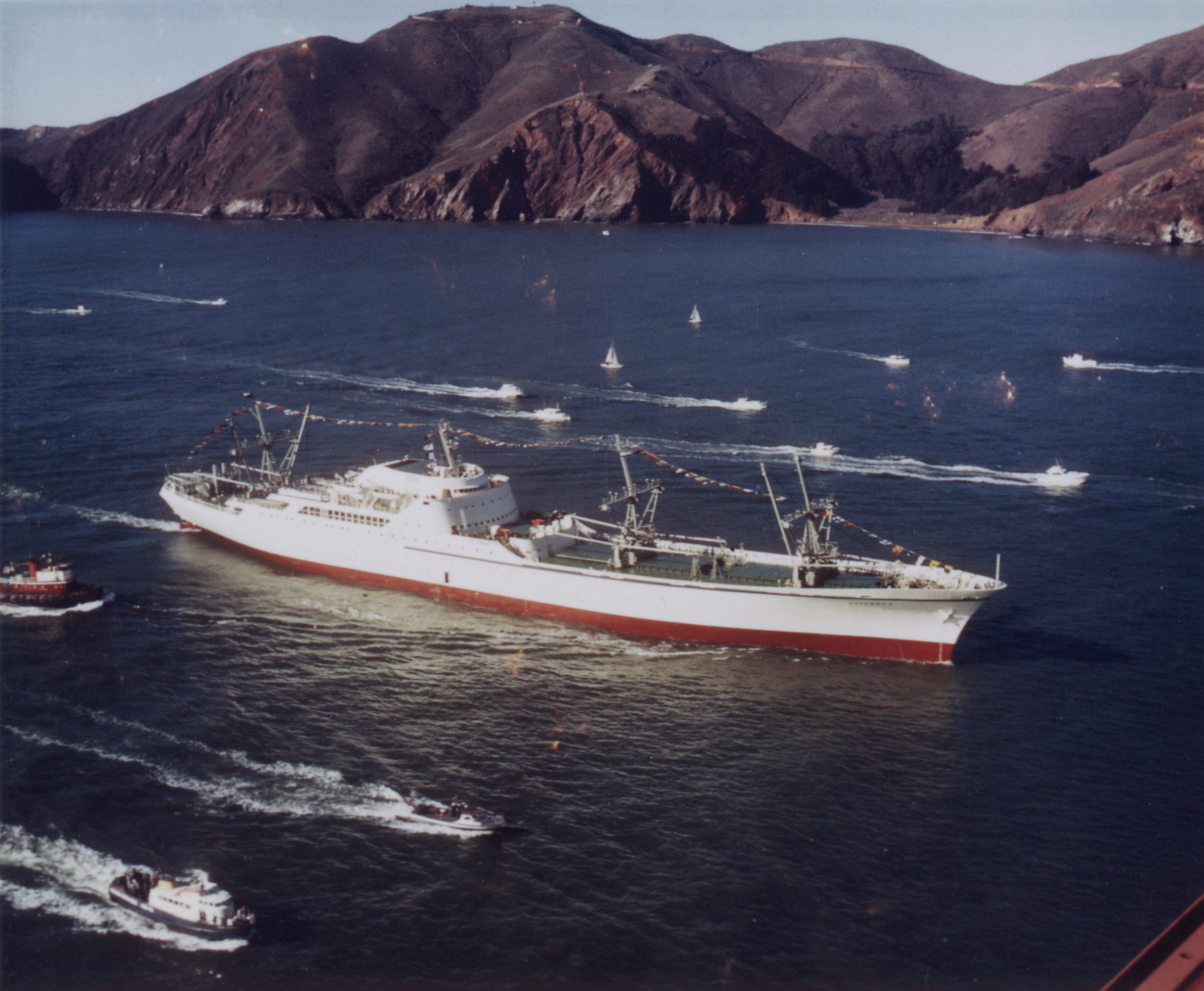 NS (Nuclear Ship) Savannah, the first commercial nuclear power cargo vessel, passes under San Francisco's Golden Gate Bridge en route to the World's Fair in Seattle, 1962..
