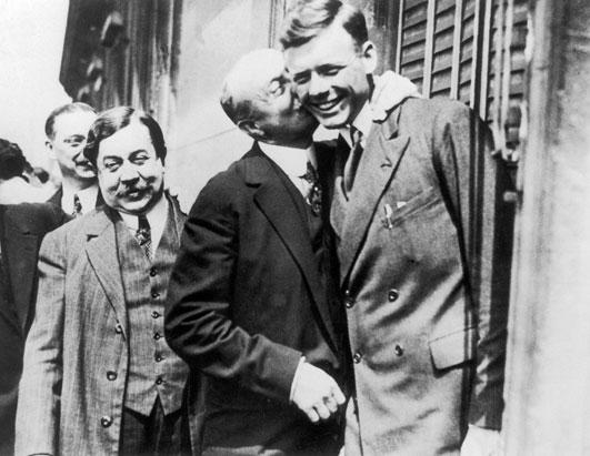 Louis Barthou (left), the War Minister Paul Painleve and the aviator Louis Bleriot - first to fly across the English Channel - seen kissing Charles Lindbergh in Paris, France, on May 25, 1927.