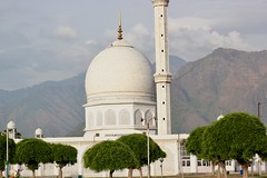 Hazratbal with mountains behind it