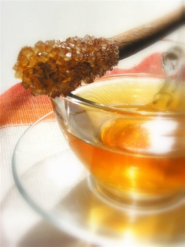 cinnamon stirrer and tea