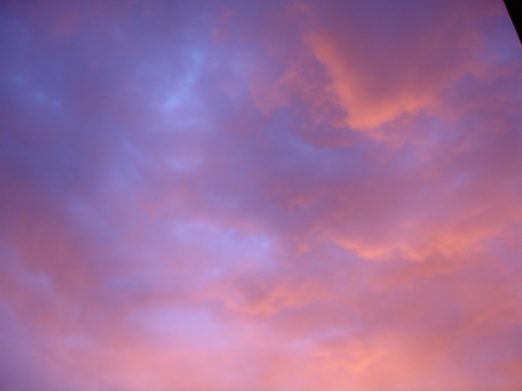 Pink And Blue Clouds Background